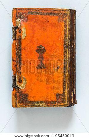Very old orange parchment bound medieval book