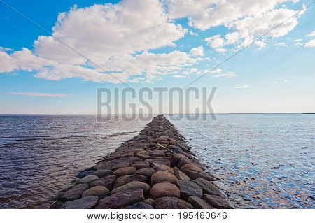 Stone pier going afar to Baltiic sea
