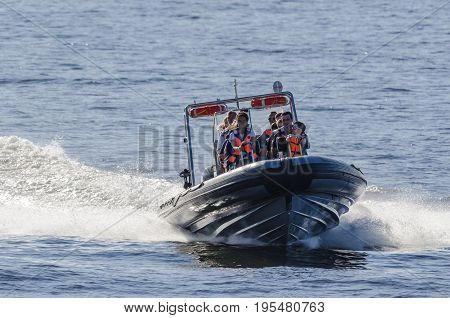 KOLOBRZEG, WEST POMERANIAN / POLAND - 2017: Holiday entertainment for summer tourists by the sea - speedboat cruise
