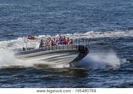 KOLOBRZEG, WEST POMERANIAN / POLAND: Holiday entertainment for summer tourists by the sea - speedboat cruise