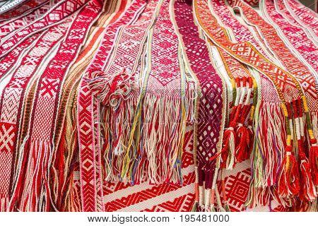Slavic belts are lying on table, handmade