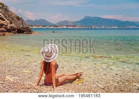 Sexy Back Of Beautiful Woman In Bikini And Creative Hat On Sea Background. Sea Coast Near Kemer, Ant