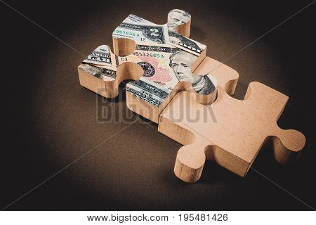 American Dollar Banknote Over Jigsaw Puzzle With Copy Space. American Dollar Concept Of Teamwork For