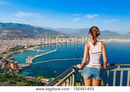 Woman Look On Landscape Of Alanya With Marina And Kizil Kule Red Tower In Antalya District, Turkey,