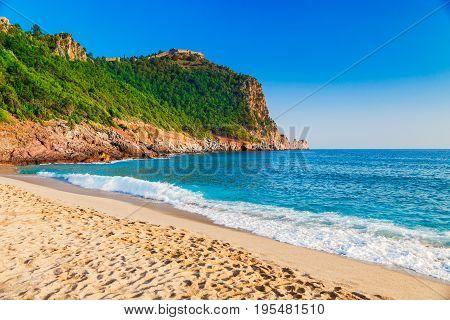 Cleopatra Beach On Sea Coast With Green Rocks In Alanya Peninsula, Antalya District, Turkey. Beautif