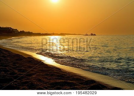 Sun and sand, Mediterranean sea with sea waves, Sunrise and rays,