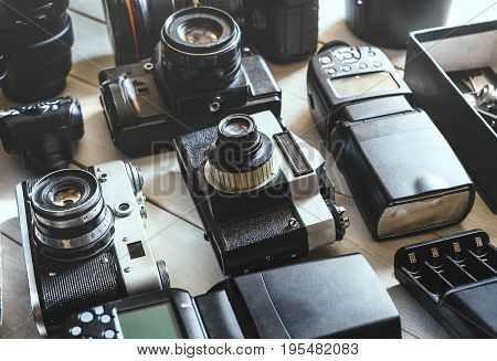 Vintage Film Camera Digital Camera Accessories And Lenses Technology Development Concept. Closeup