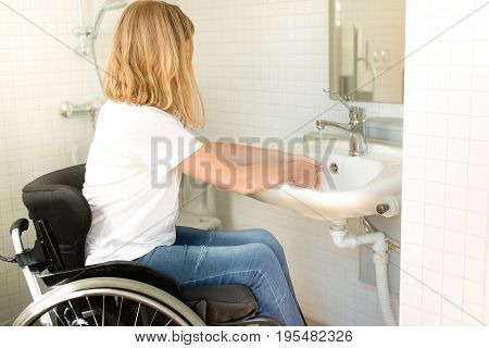 Person In A Wheelchair Washing Hands