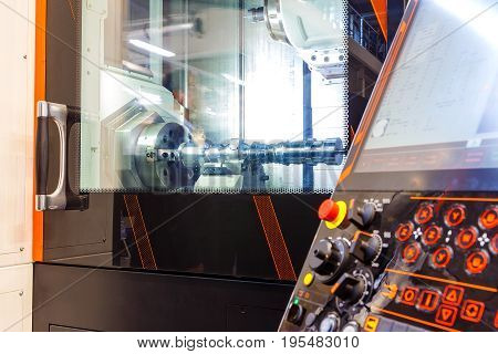 Metalworking CNC milling machine. Cutting metal modern processing technology. Small depth of field.