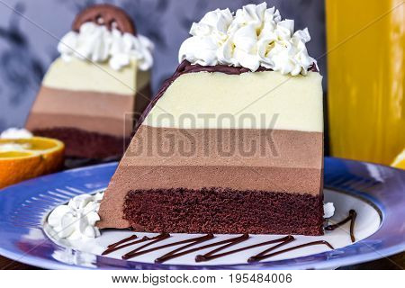 cake mousse three chocolates slice of cake on plate