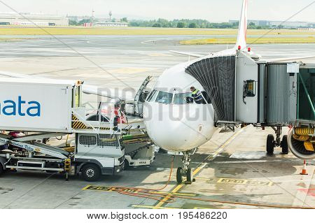 PRAGUE, CZECH REPUBLIC - JUNE 16, 2017: Vaclav Havel Prague International Airport, Ruzyne, Czech Republic. Air plane in airport terminal loading passengers and cargo luggage. Boarding aircraft process.
