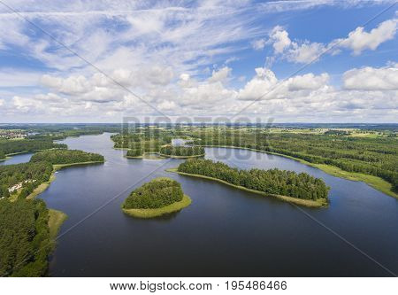 Aerial View Of Green Islands And Clouds At Summer Sunny Day.wydminy Lake On Masuria In Poland.