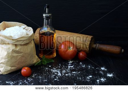 Composition Of Bag Of Wheat Flour, Oil, Tomato And Rolling Pin. Preparation For Kneading Dough, Baki