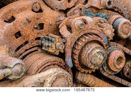 Old Machinery Parts. Corroded Metal Gearwheels Closeup.