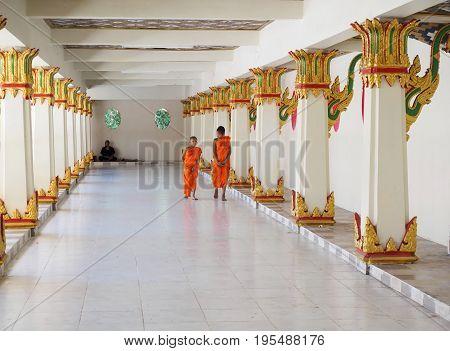 Sangkhlaburi Thailand- March 05 2017: Two Buddhist novice monks walking along the corridor of the temple in Sangkhlaburi District, Kanchanaburi Province Thailand.