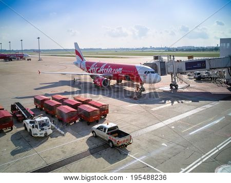 Bangkok Thailand - April 20 2017: The Air Asia airplane at Donmueang International Airport boarding passengers on the aircraft for traveling to Kuala Lumpur Malaysia on April 20 2017.