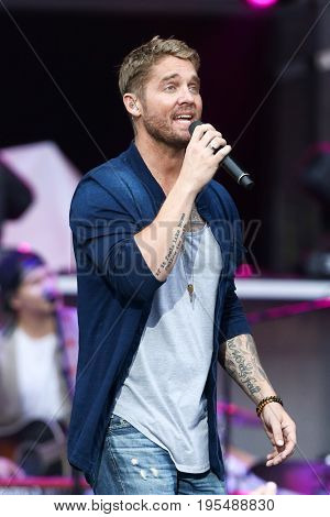 WANTAGH, NY-JUL 14: Brett Young performs during the You Look Good World Tour at Northwell Health at Jones Beach Theatre on July 14, 2017 in Wantagh, New York.