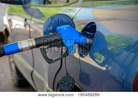 The car is fueled with gasoline at the gas station