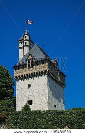 Close-up of tower of the Dukes of Savoy's castle, with blue sky in the city center of Chambéry. Located in the department of Savoie, Auvergne-Rhône-Alpes region in south-eastern France