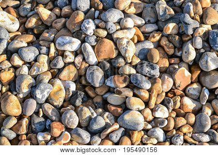 Various oblong sea stones background texture. Zen calm