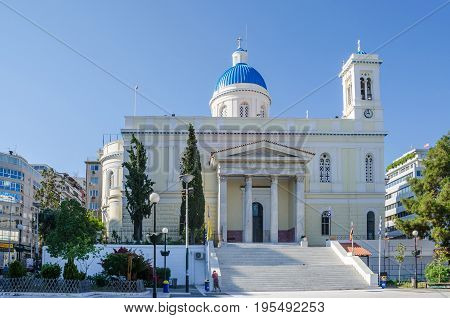 Port of Piraeus Greece - Mai 30 2017: The church of St.Nicholas in Port of Piraeus. Dedicated to Saint Nikolaos the patron saint of seamen it is a remarkable example of the late 19th century architecture following the standards of neoclassicism.