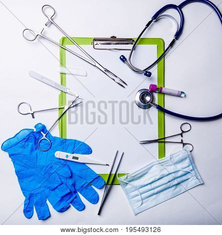 Doctor tools on blue surface. Medical concept