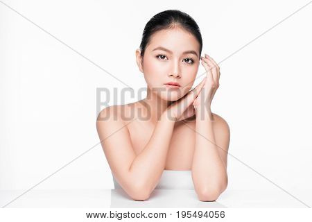 Facial treatment. Beautiful asian woman portrait with perfect skin.