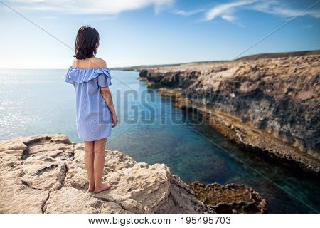 Young Woman Enjoying Beautiful Sea View On Greco Cape