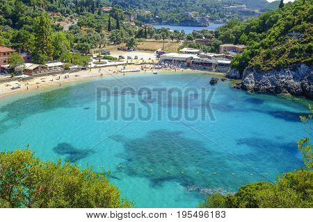 PALEOKASTRITSA CORFU GREECE - JULY 3 2017: Aerial view on the bay and beach Paleokastritsa with crystal sea water on the Island Corfu Greece.