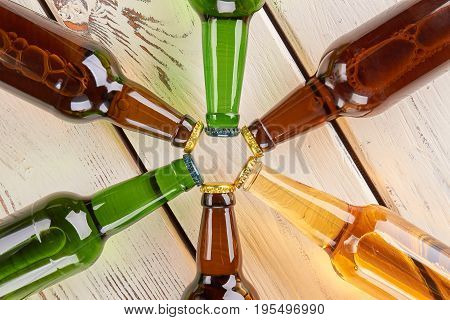 Star from glass bottles of beer. Decoration from closed bottles with alcohol, top view.