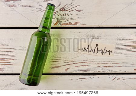 Bottle of beer, heartbeat image. Alcohol make problems with the heart.