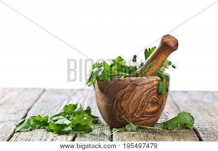 Different Herbs On A Old Wooden Table .