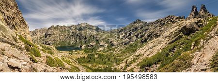 Panoramic view of Lac de Melo and the peaks above Lac de Capitello at the head of the Restonica valley near Corte in Corsica