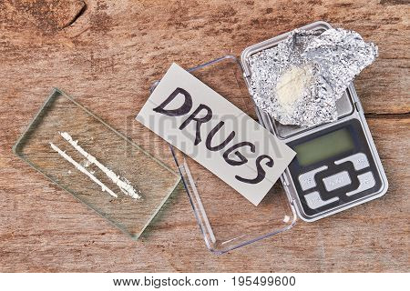 Scales, foil, narcotics, message. Tool for drugs weight, top view.