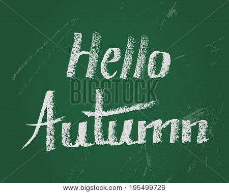 Hello autumn, card. Hand drawn lettering by chalk on green blackboard. Design elements for new school year..