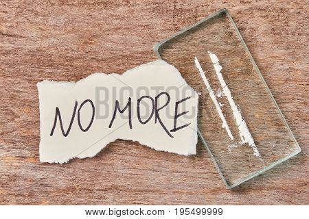 Paper message, narcotics, wooden background. Drugs not save from pain.