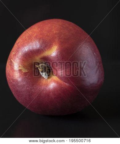 Ripe Peach on black background. Peach Clous-up.