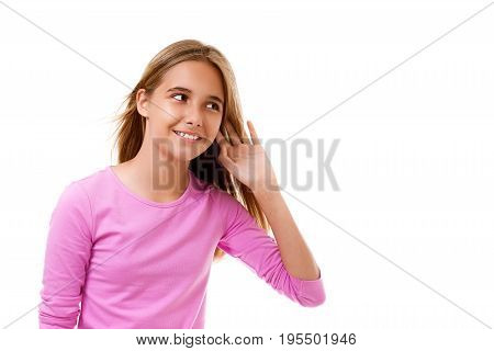 Picture of beautiful young girl listening gossip on white background with copyspace