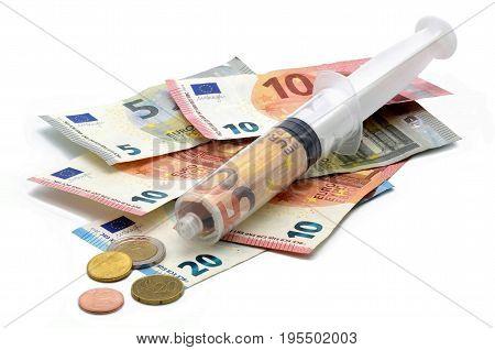 financial syringe on many euros white background