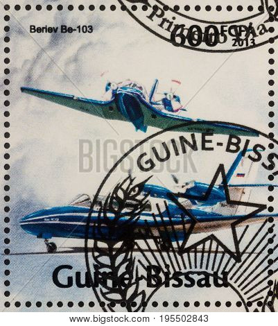 Moscow Russia - July 15 2017: A stamp printed in Guinea-Bissau shows aircraft - light amphibian Beriev Be-103 series