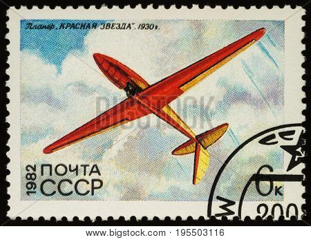 Moscow Russia - July 16 2017: A stamp printed in USSR shows old glider Red Star by S.P. Korolev (1930) series