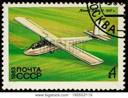 Moscow Russia - July 16 2017: A stamp printed in USSR (Russia) shows flying glider KAI-12 by Simonov (1957) series
