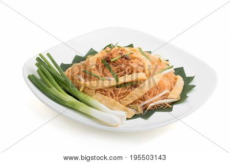stir fried rice vermicelli with omelet spring onion and bean sprout on white ceramic plate isolated on white background with clipping path and soft shadow