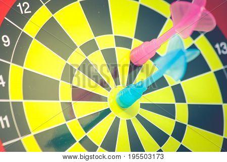 Close up blue dart hit target on dart board in vintage filter effect. (Soft Focus)