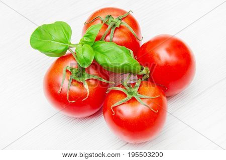 Group Of Fresh Resd Tomatoes With Basil