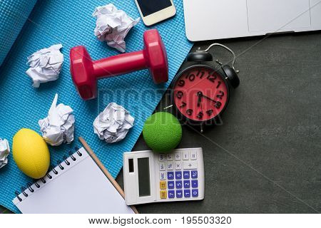 Time for exercising clock dumbbell yoga mat in the office