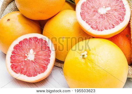 a canvas sack full of fresh  grapefruit