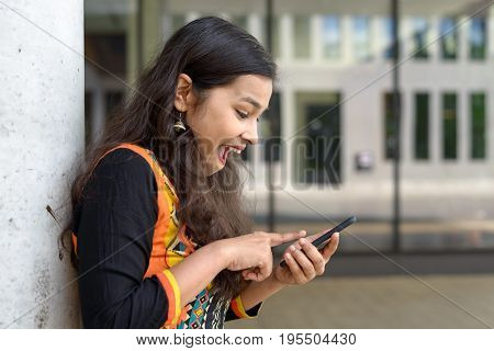 Excited Young Indian Girl Exclaiming At A Sms