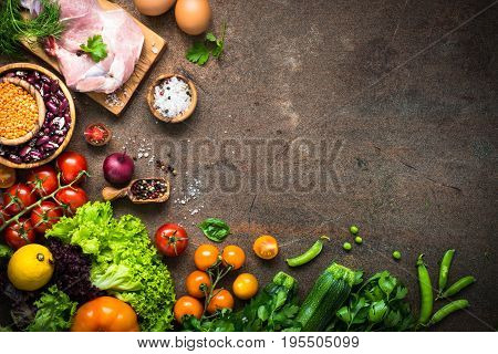 Balanced food background. Organic food for healthy nutrition. Meat beans and vegetables. Top view copy space at dark stone table.