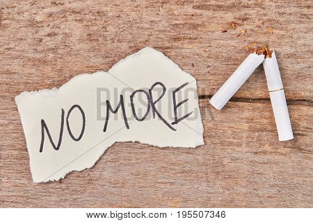 Broken cigarette, message no more. No more cigarette smoking concept.